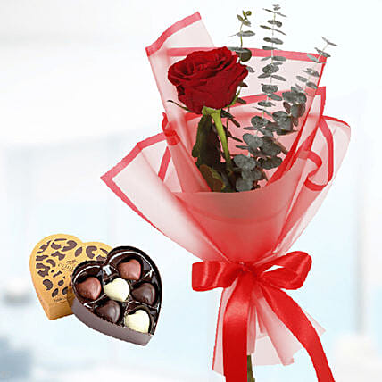 red roses bouquet with chocolate surprise online:Flower Arrangements in Qatar