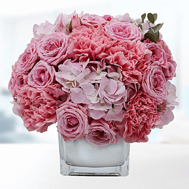 delicate pink blooms in vase online:Flower Arrangements to Qatar