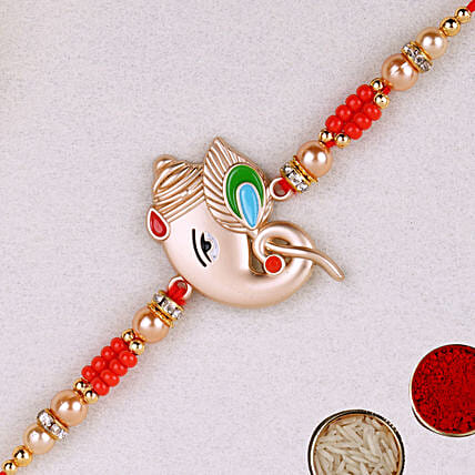Alluring Rose Gold Ganesha Rakhi:All Gifts