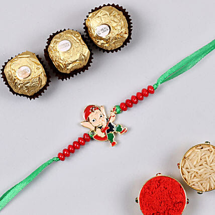 Appealing Bal Ganesha Kids Rakhi And 3 Pcs Ferrero Rocher:Gifts for Kids in Singapore
