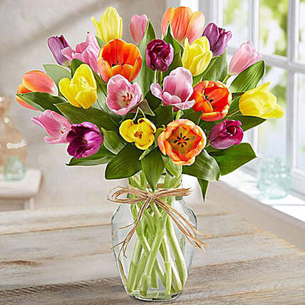 Colourful Tulips In Glass Vase:Send Flowers to Singapore