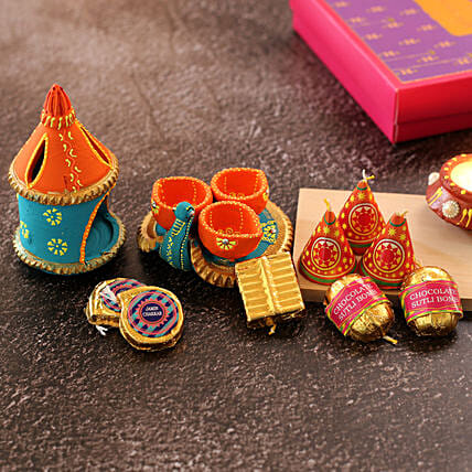 Two Diyas With Cracker Shaped Chocolates