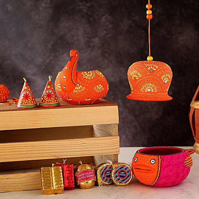 Beautiful Diyas With Bell And Cracker Chocolates