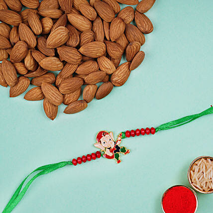 Appealing Bal Ganesha Kids Rakhi And Almonds:Send Cartoon Rakhi to UAE