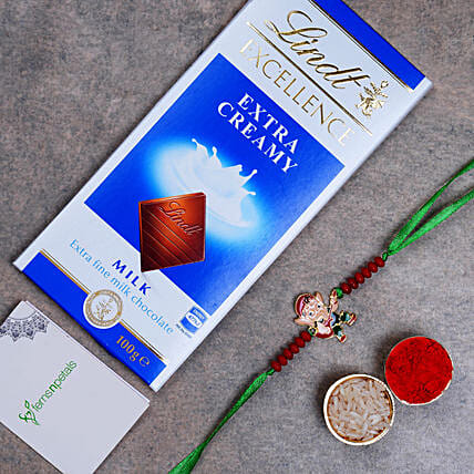 Appealing Bal Ganesha Kids Rakhi And Lindt Chocolate:Send Cartoon Rakhi to UAE