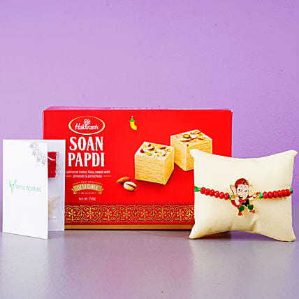 Appealing Bal Ganesha Kids Rakhi And Soan Papdi:Send Cartoon Rakhi to UAE