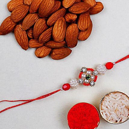 Appealing Floral Rakhi And Almonds