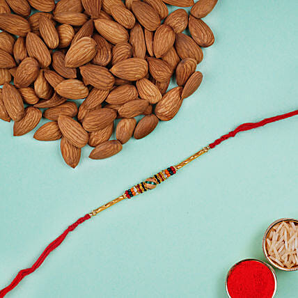 Beautiful Meena Thread Rakhi And Almonds