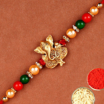 Golden Fancy Ganesha Rakhi:Send Ethnic Rakhi to UAE