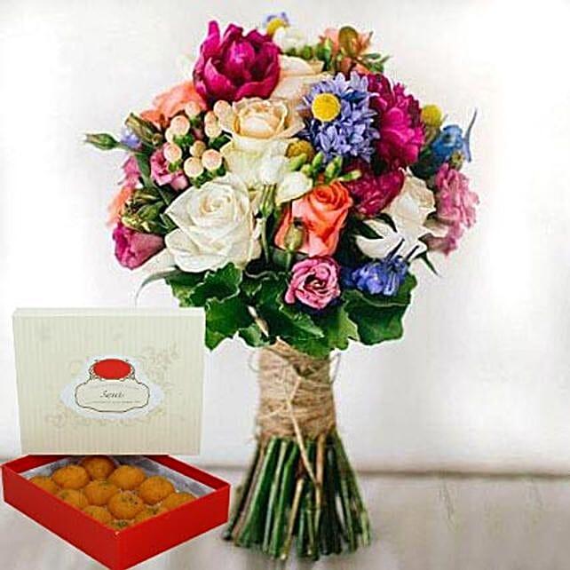 Mesmerizing Flowers and Motichoor Laddoo Combo:Sweet Delivery in UAE