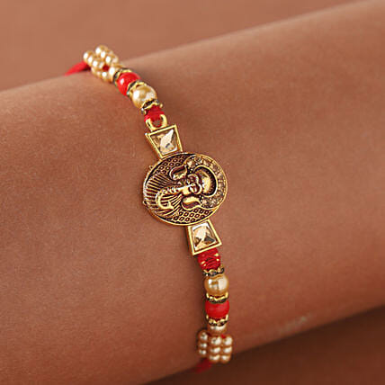 Mini Golden Ganesha Rakhi:Send Ethnic Rakhi to UAE