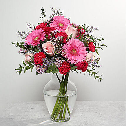 Mixed Flowers In Glass Vase:Send Carnation Flower to UAE