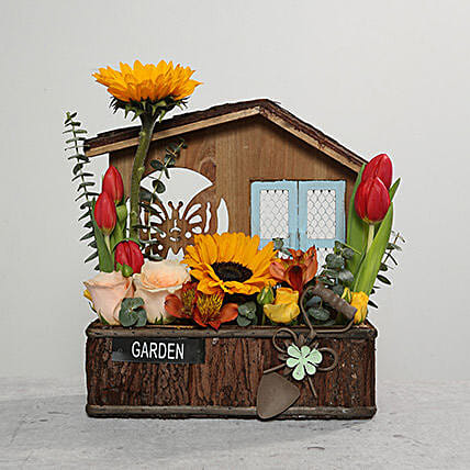 Mixed Flowers In Hut Shaped Base