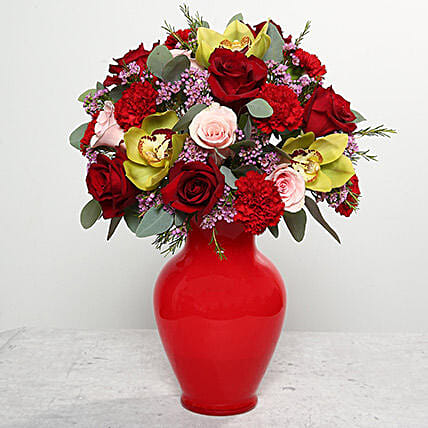 Mixed Flowers In Red Glass Vase:Send Carnation Flower to UAE
