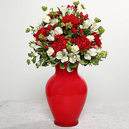 Red Carnations In Red Glass Vase