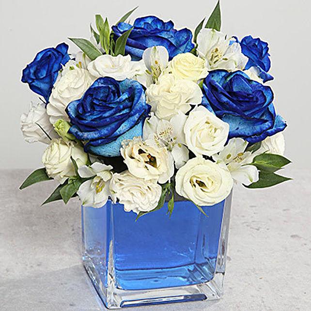 Blue Roses Arrangement In Glass Vase