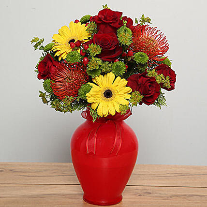 Mixed Flowers Arrangement In Red Glass Vase