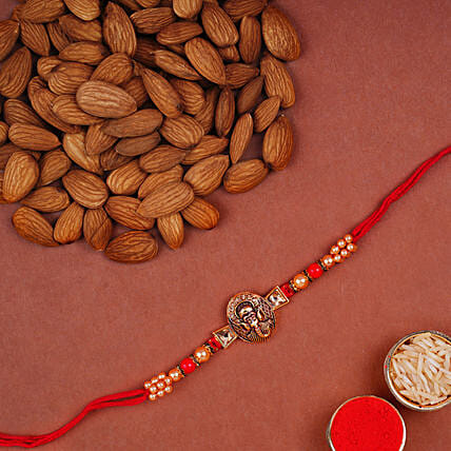 Mini Golden Ganesha Rakhi And Almonds