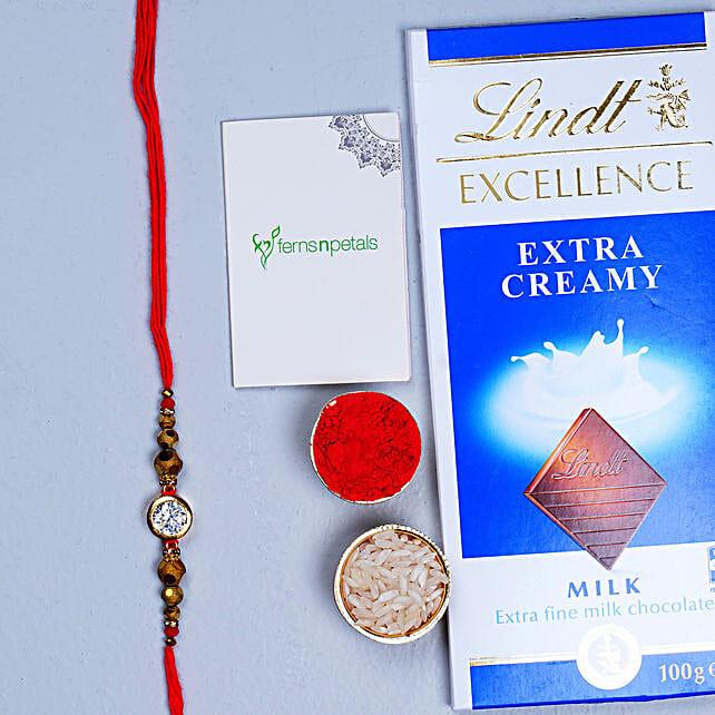 Natural White Stone Rakhi And Lindt Chocolate
