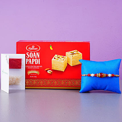 Elegant Pearl Thread Rakhi And Soan Papdi:Single Rakhi to USA
