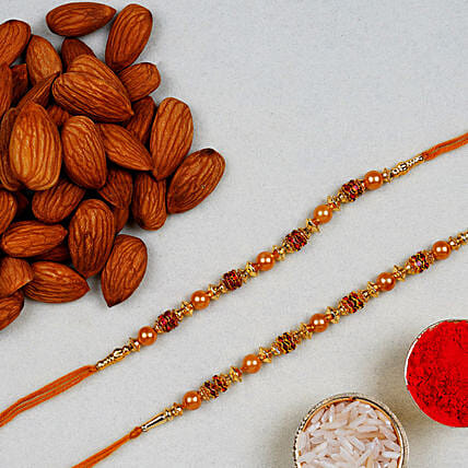 Golden Red Thread Rakhi And Almonds