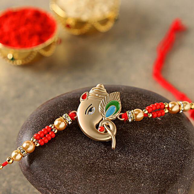 Alluring Rose Gold Ganesha Rakhi