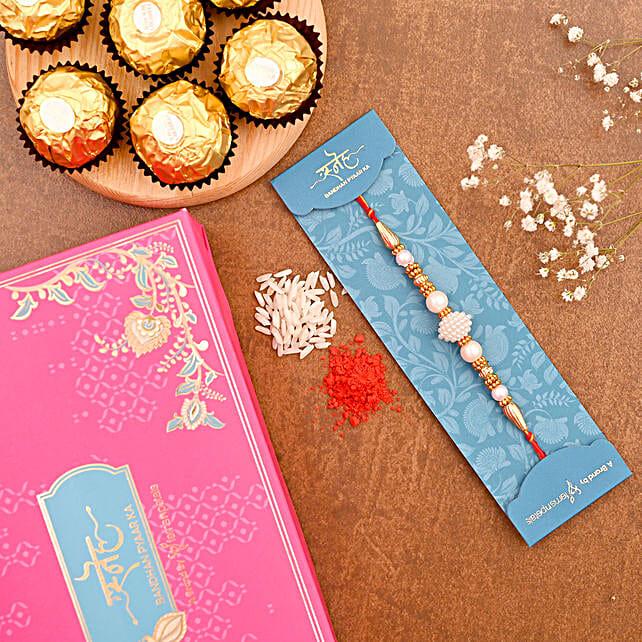 Elegant Pearl Mauli Rakhi And 3 Pcs Ferrero Rocher