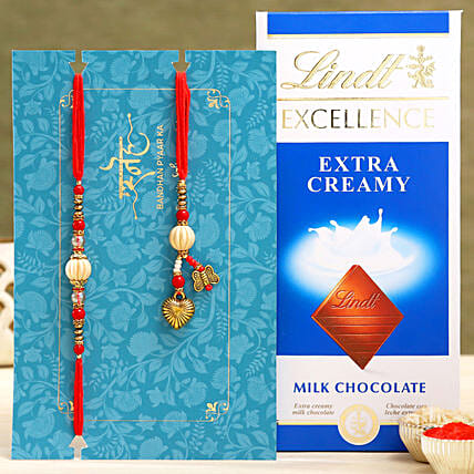 Red Pearl And Lumba Rakhi Set With Lindt