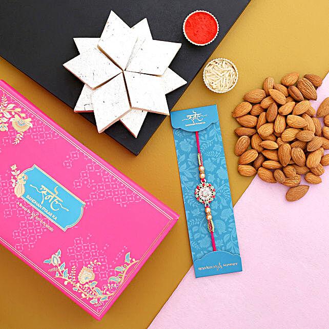 Floral Design Rakhi And Almonds With Kaju Katli