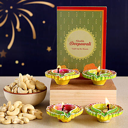 Floral Diyas With Greeting Card And Cashews